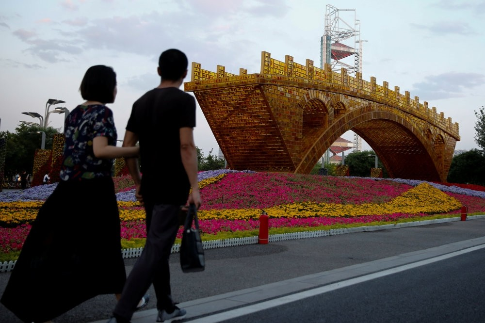 The ,Golden Bridge on Silk Road, by artist Shuyong was set up ahead of the Belt and Road Forum in Beijing, which will host world leaders on May 14-15. (Reuters Photo)