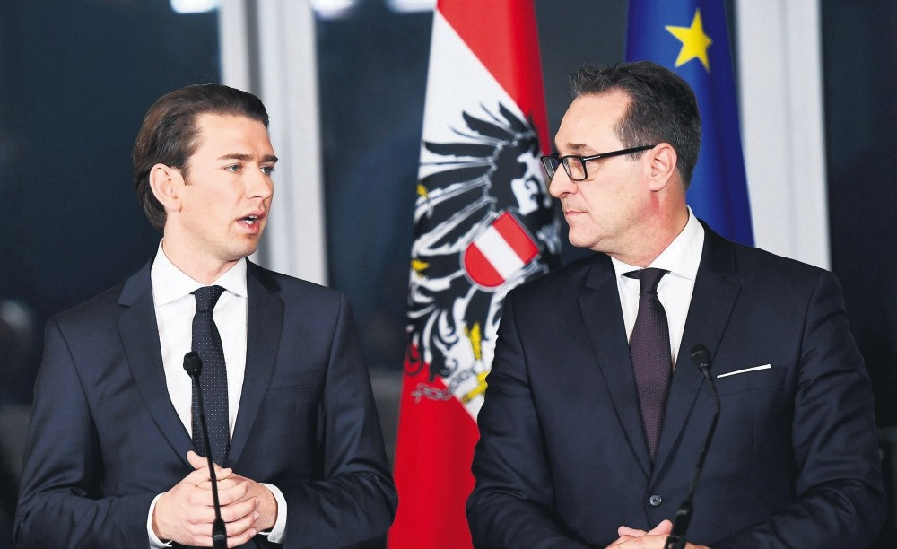 Austrian foreign minister and the leader of the Austrian Peoples Party Sebastian Kurz (L) and the head of the right-wing Austrian Freedom Party Heinz-Christian Strache attend a news conference at Kahlenberg hill in Vienna, Austria, Dec. 16.