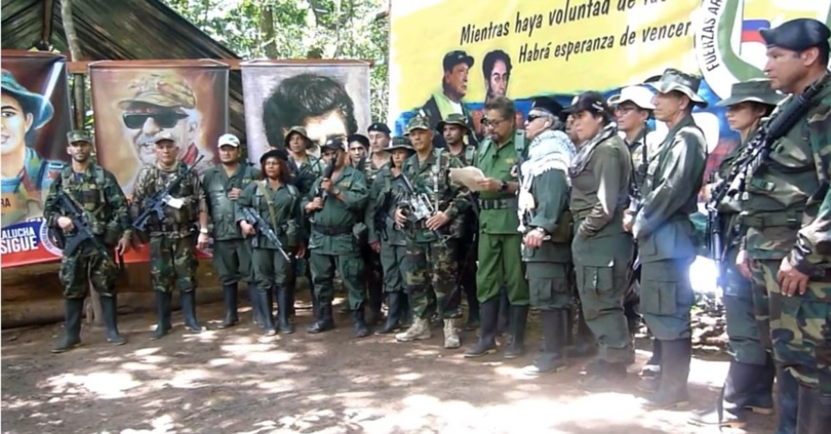 This screengrab from Youtube shows FARC commander Ivan Marquez, surrounded by armed militants, reading a text calling for arms.