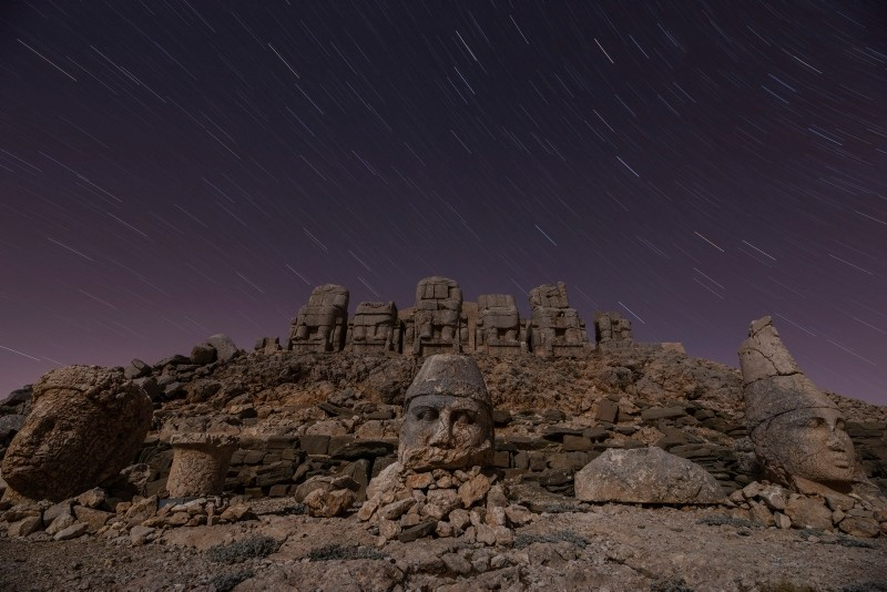 Sunset illuminates ancient statues at Turkey's Mount Nemrut