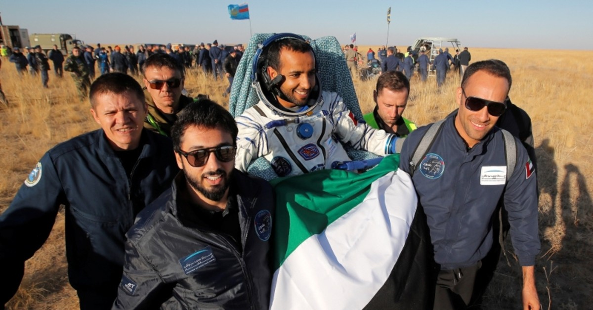 Russian space agency Roscosmos rescue team members and UAE specialists carry United Arab Emirates' astronaut Hazzaa Ali Almansoori, returning from a mission to the International Space Station (Reuters Photo)