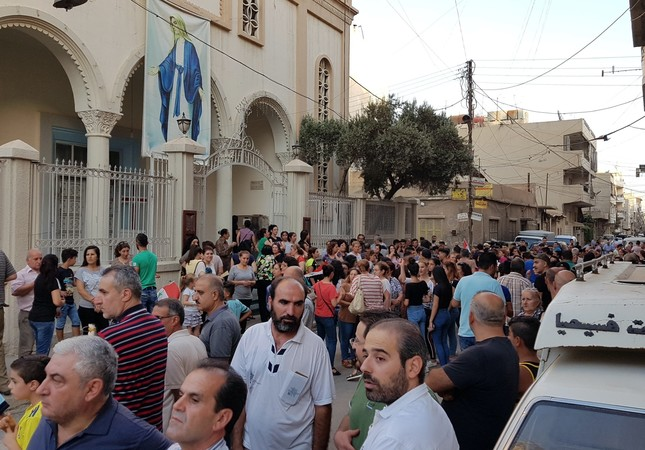 Syrian Christians gather near their church to protest against the PKK-affiliated YPG terrorists shutting down their schools in the northwestern Syrian town of Qamishli, Aug. 18.