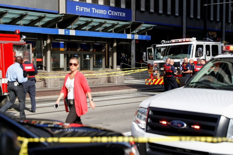 Emergency personnel and police respond to a reported active shooter situation near Fountain Square, Thursday, Sept. 6, 2018, in Cincinnati. (AP Photo)