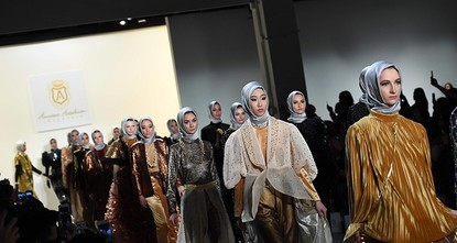 pIn just two seasons, Indonesian Muslim designer Anniesa Hasibuan has made the headscarf her trademark -- and dazzled New York fashion week's catwalk this week by styling it with flowing,...