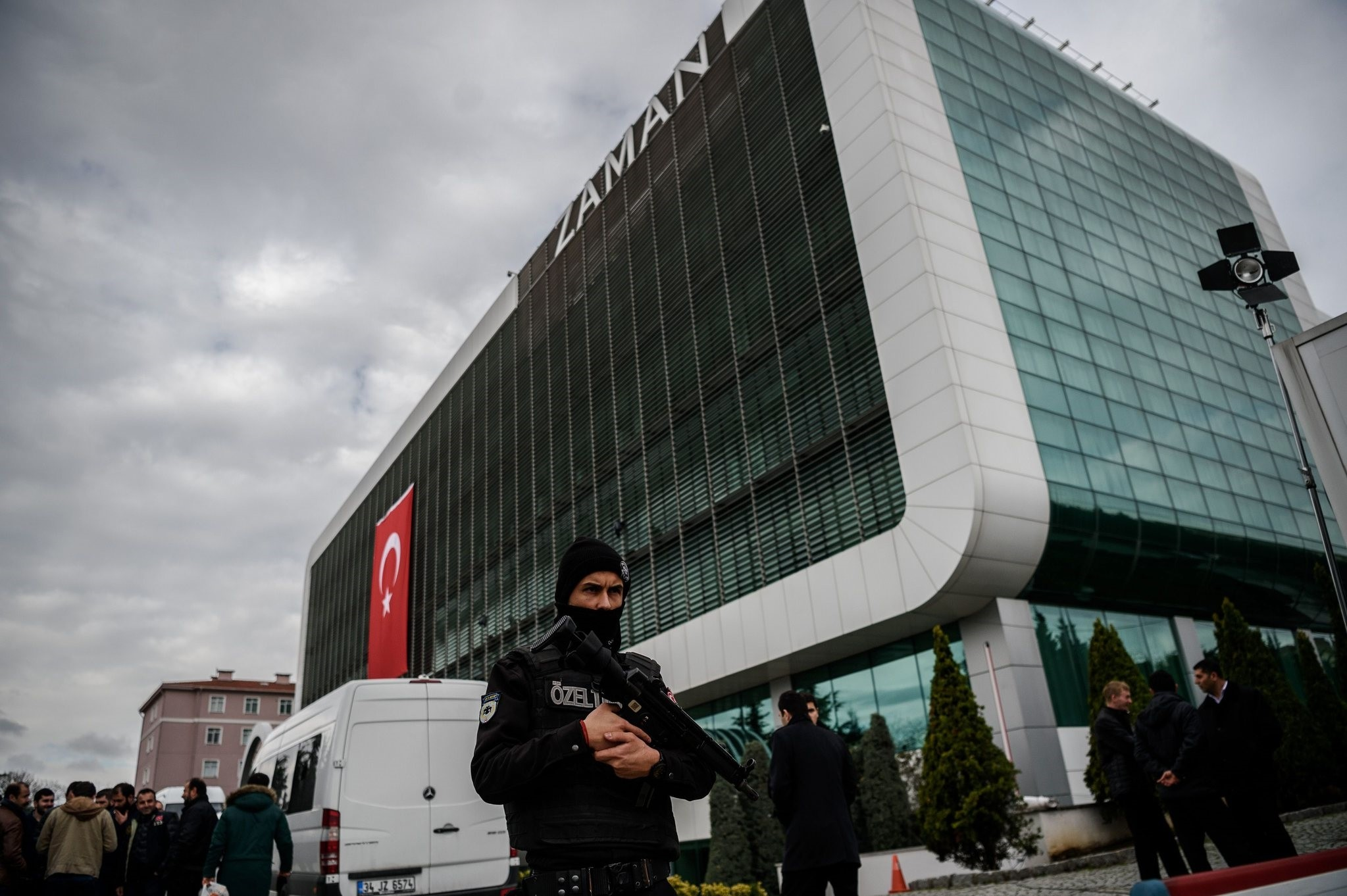 Turkish police stand guard in front of the building of FETu00d6-linked newspaper Zaman in Istanbul, March 5, 2016, after it was taken from the group.