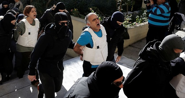 In this Wednesday, Nov. 29, 2017 file photo, DHKP-C terrorist Şadi Naci Özpolat is escorted by anti-terror police while arriving at a court in Athens. A Greek court has rejected a Turkish extradition request for Özpolat, on March 6, 2018. (Reuters Ph