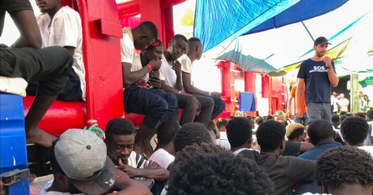 Rescued migrants gather aboard the 'Ocean Viking' rescue ship, jointly operated by French NGOs SOS Mediterranee and Medecins sans Frontieres (MSF Doctors without Borders) on August 23, 2019. (AFP Photo)