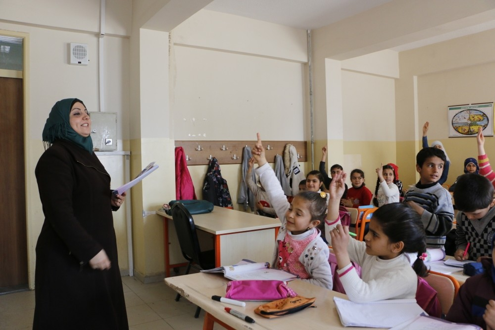 A Syrian female teacher teaches a group of refugee children in u015eanlu0131urfa. Most refugees are women and children who are viewed as most vulnerable members of the refugee community.