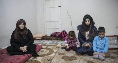 Syrian mother holds onto life after losing entire family