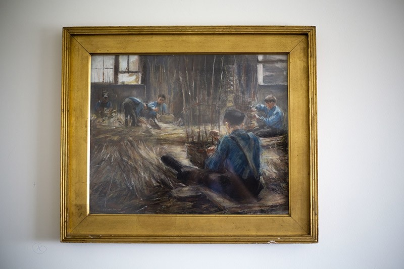 In this photo taken on Wednesday, April 5, 2017, Max Liebermann's ,Basket Weavers, painting hangs in a law office in Jerusalem. (AP Photo)