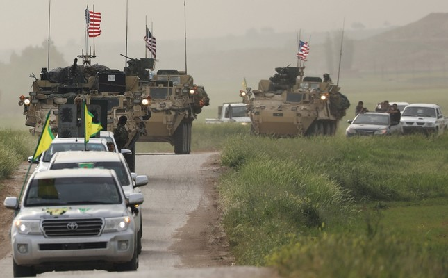 YPG terrorists head a convoy of U.S. military vehicles in the town of al-Darbasiyah next to the Turkish border, April 28, 2017.