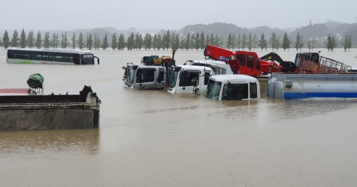 A view of submerged vehicles in a flooded parking lot in the aftermath of Typhoon Mitag, in Gangneung, South Korea, Oct. 3, 2019. (IHA Photo)