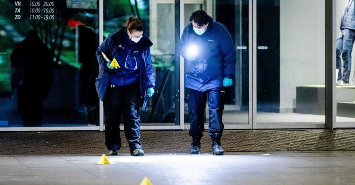 Forensic workers investigate at the Grote Marktstraat, one of the main shopping streets in the center of the Dutch city of The Hague, after several people were wounded in a stabbing incident on November 29, 2019. (AFP Photo)