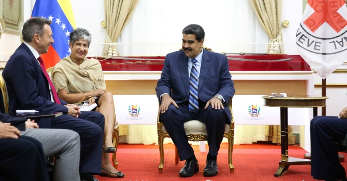 Venezuela's President Nicolas Maduro and Peter Maurer, president of the International Committee of the Red Cross (ICRC), talk during their meeting at Miraflores Palace in Caracas, Venezuela April 9, 2019. (Reuters Photo)