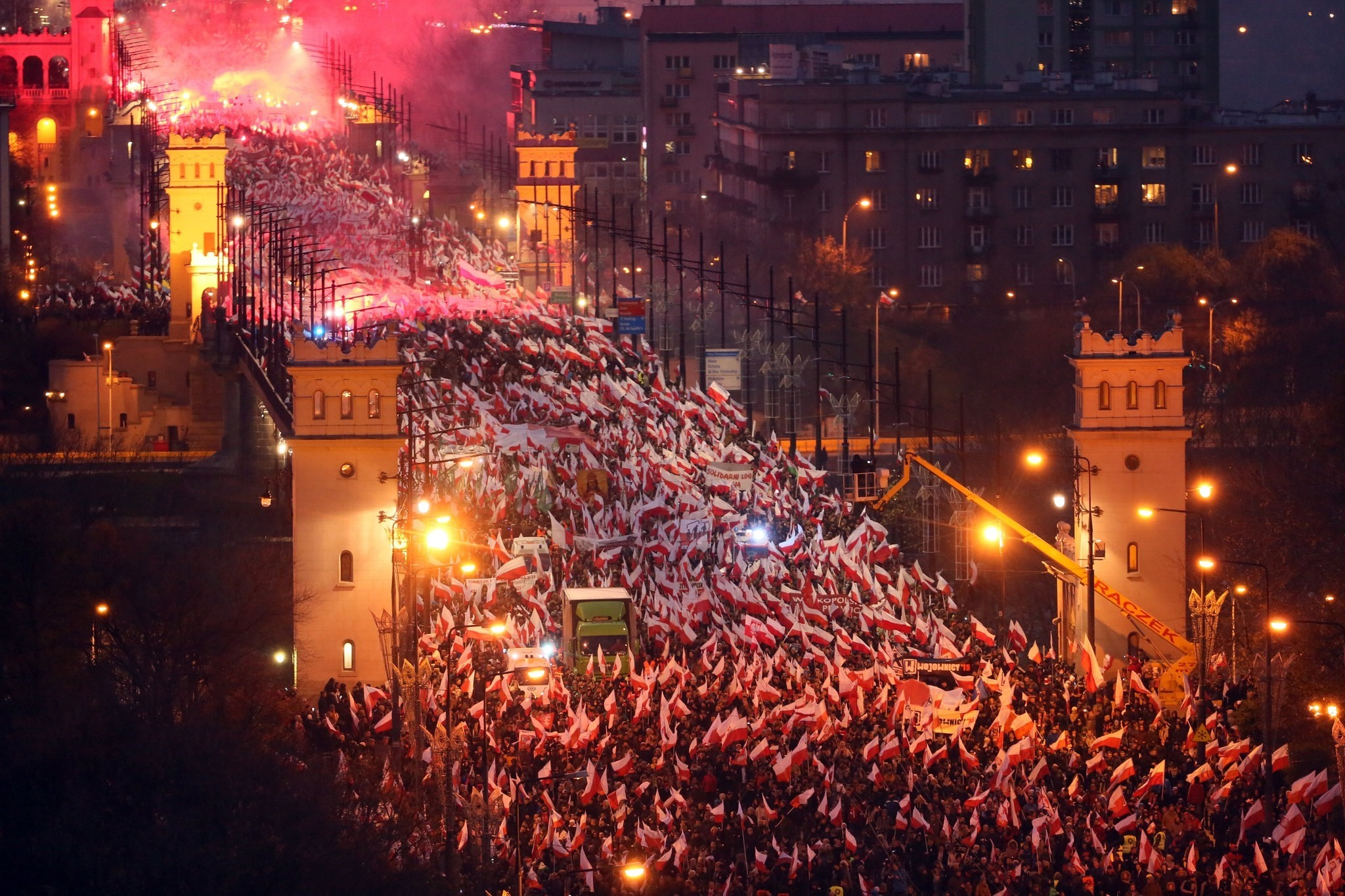 Polish nationalists walk through the Poniatowski Bridge as they take part in the March of Independence 2017 under the slogan 'We want God' as part of Polish Independence Day celebrations in Warsaw, Poland, 11 November 2017. (EPA Photo)