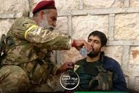 Kurdish fighter helps captured YPG terrorist near Afrin's Jandaris