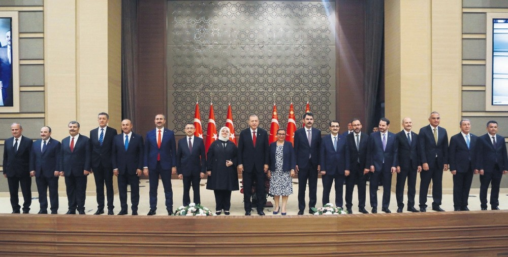 President Recep Tayyip Erdou011fan (C), poses with the members of the newly appointed Cabinet following a news conference at the Beu015ftepe Presidential Complex in Ankara, July 9.