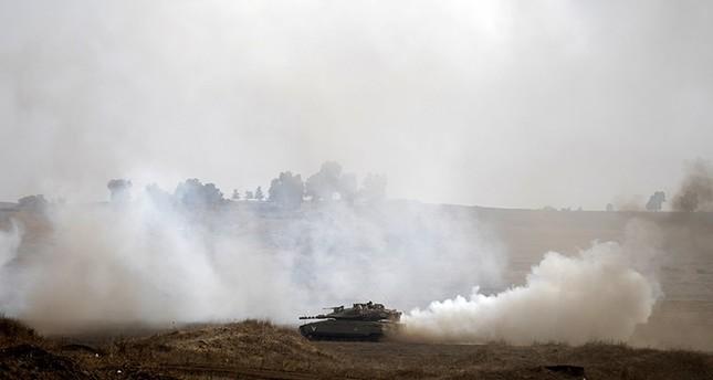 Israeli tanks train at the Golan Heights area, on the Israeli-Syrian border (EPA Photo)