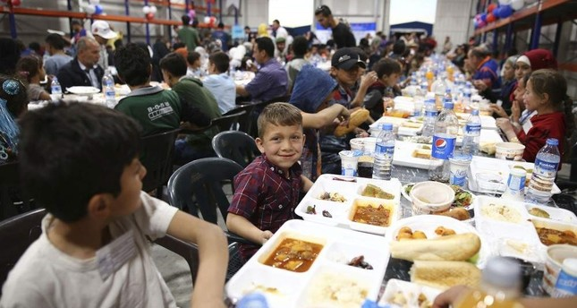 Syrian refugee children having dinner hosted by Turkey's AFAD in an area liberated as part of Operation Euphrates Shield in this undated photo (Sabah File Photo)