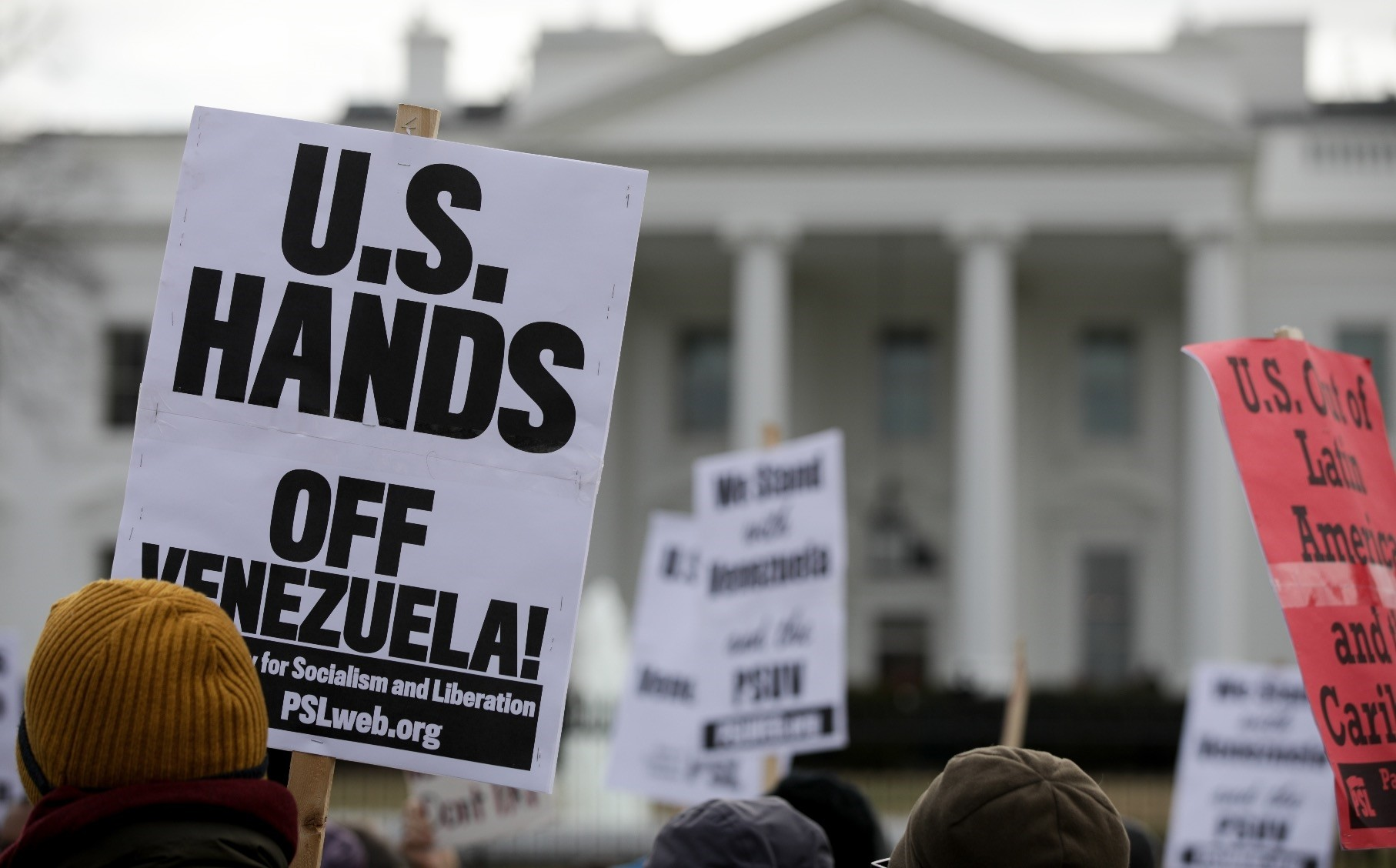 People attend a demonstration against the U.S.u2019s involvement in the coup attempt against Venezuelau2019s elected President Nicolas Maduro, in front of the White House, Jan. 27, 2019.