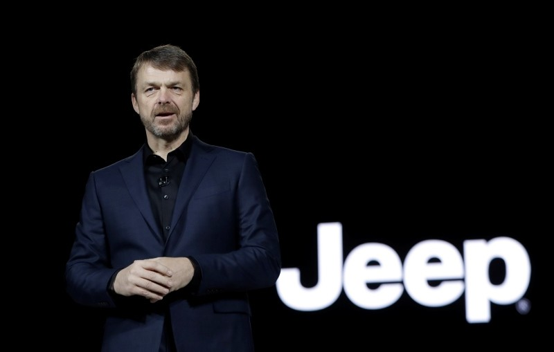 Mike Manley, head of Jeep Brand, introduces the 2019 Jeep Cherokee during the North American International Auto Show, in Detroit, USA.  (AP Photo)