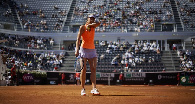Maria Sharapova of Russia wipes sweat from her face during a tennis match against Christina Mchale of the United States, at the Italian Open tennis tournament, in Rome, Monday, May 15, 2017. (AP Photo)