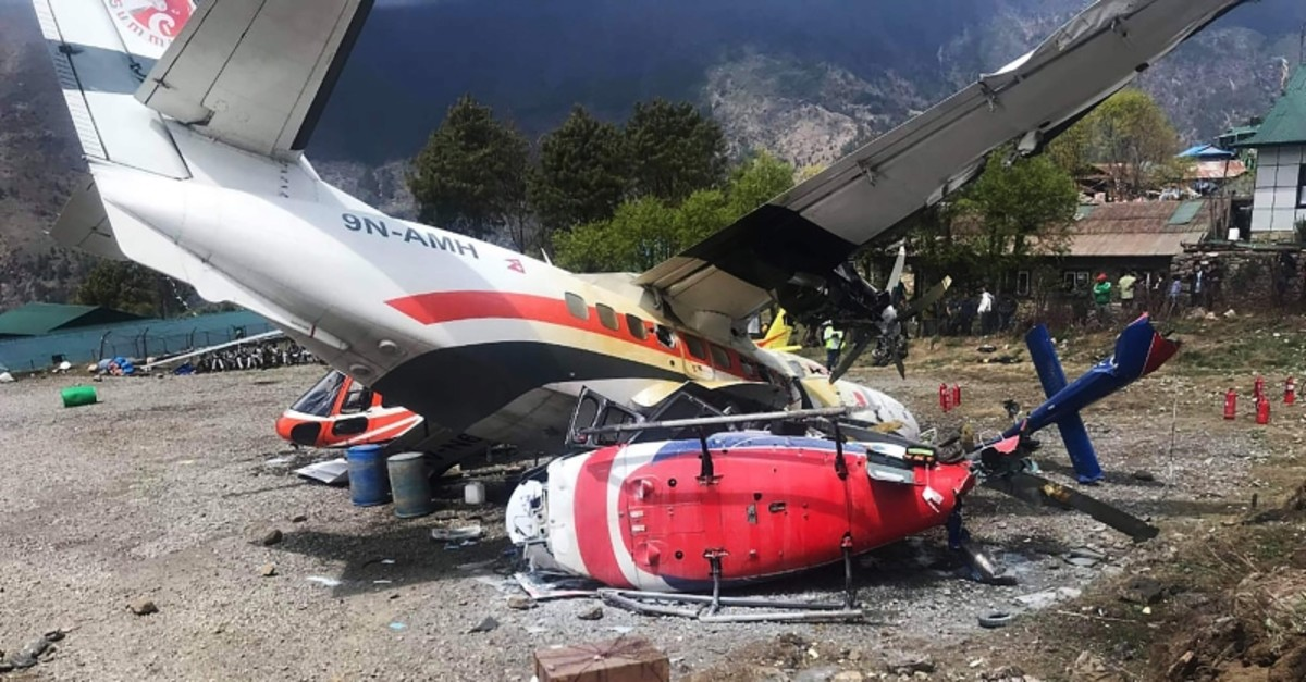 A Summit Air Let L-410 Turbolet aircraft bound for Kathmandu is seen after it hit two helicopters during take off at Lukla airport, the main gateway to the Everest region. (AFP Photo)