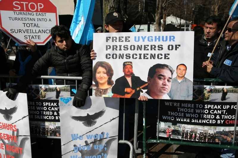 In this March 15, 2018, file photo, Uighurs and their supporters rally across the street from United Nations headquarters in New York. (AP Photo)
