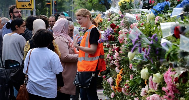 People leave flowers at the entrance of the Turkish mosque, Rotterdam to protest the anti-Islamic Pediga group's plan to roast pork in front of it during the fast-breaking meal, June 7.