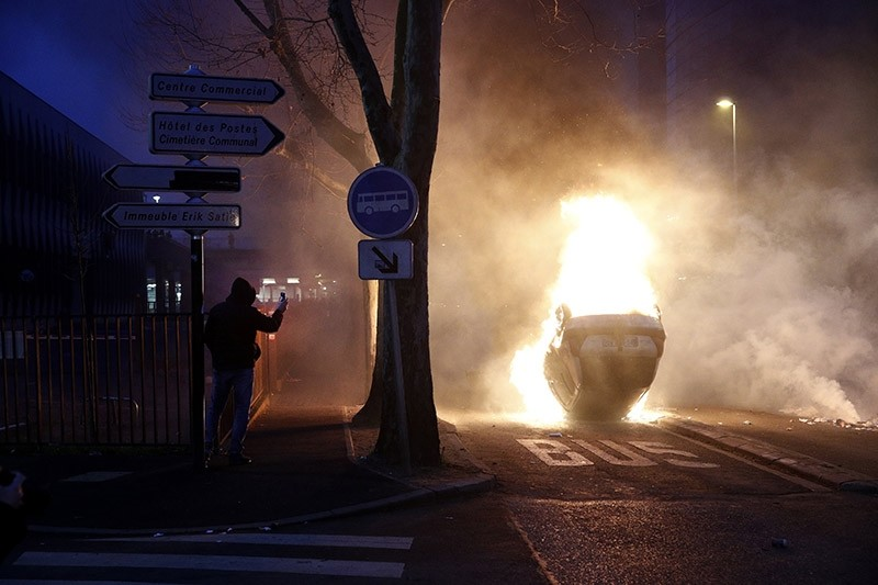 A car burns as protesters clash with French riot police in Bobigny, a suburb of Paris, France on Feb. 11, 2017. (EPA Photo)