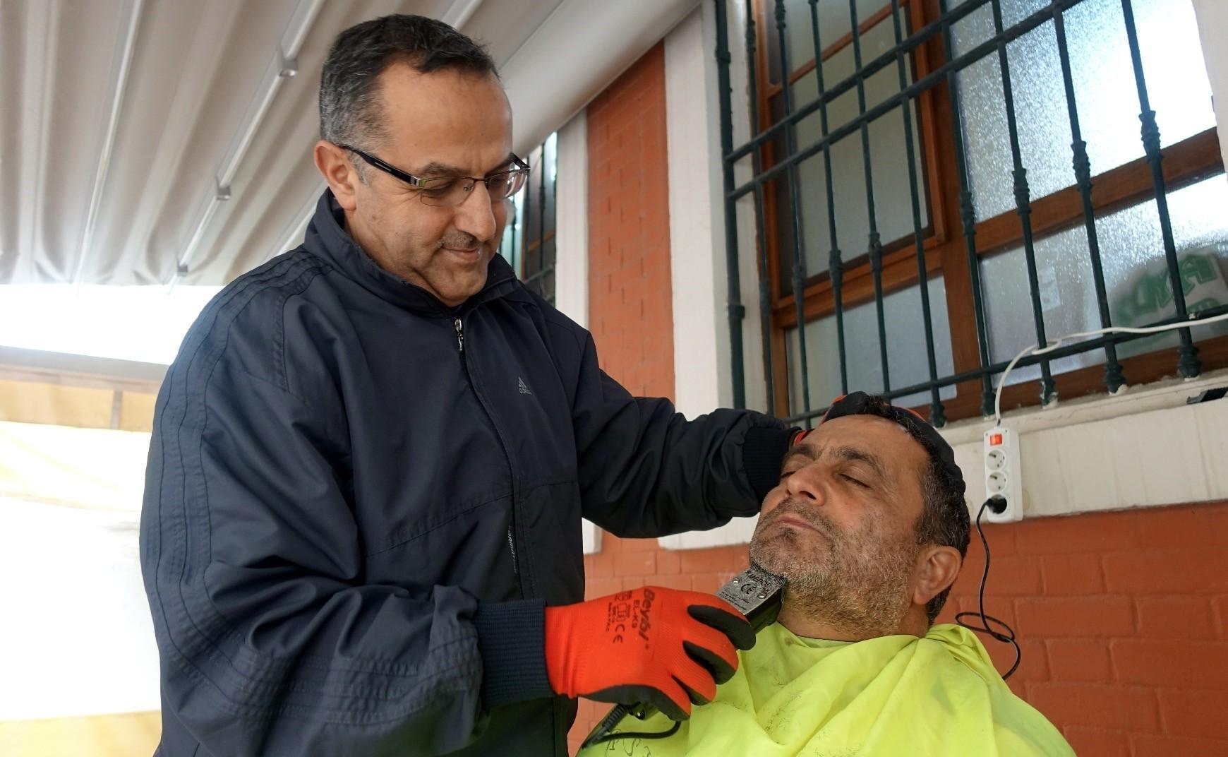 Imam  Osman Gu00f6rkem shaves the beard of a homeless man in Selimiye Hatun Mosque in Beyou011flu, Istanbul.