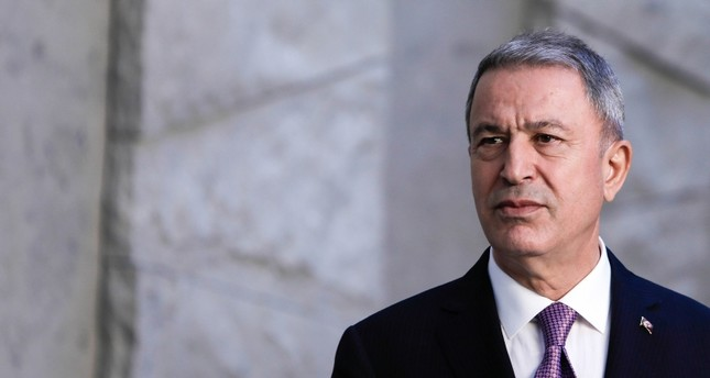 Turkish Defence Minister Hulusi Akar looks on before posing for a family picture during the NATO Defence Ministers meeting in Brussels on June 27, 2019. (AFP Photo)