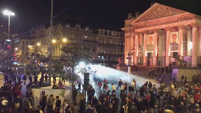 Video grab shows riot police spraying water into the crowd using a water cannon in Brussels, Belgium November 11, 2017 in this image taken from video obtained from social media. (Reuters Photo)