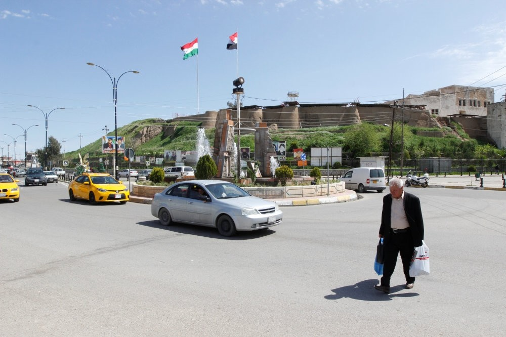 The KRG flag and the Iraqi flag are seen on a building in Kirkuk, Iraq yesterday.