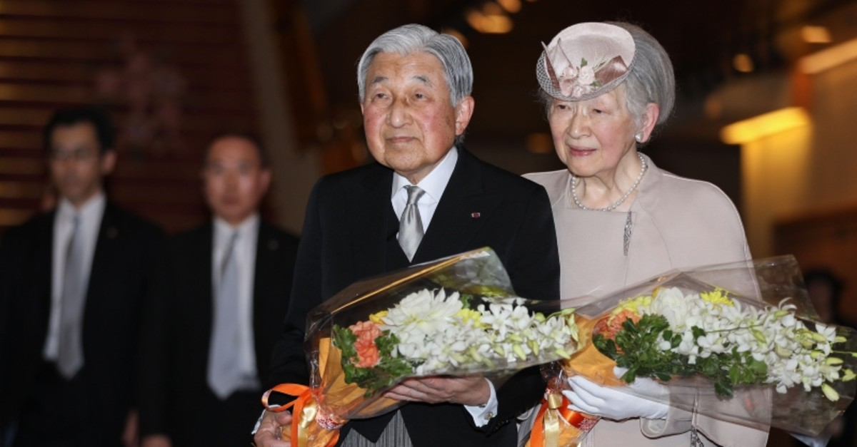 Japan's Emperor Akihito (L) and Empress Michiko depart after attending a ceremony to mark the 30th anniversary of the emperor's coronation to the throne at the National Theatre in Tokyo on February 24, 2019. (AFP Photo)