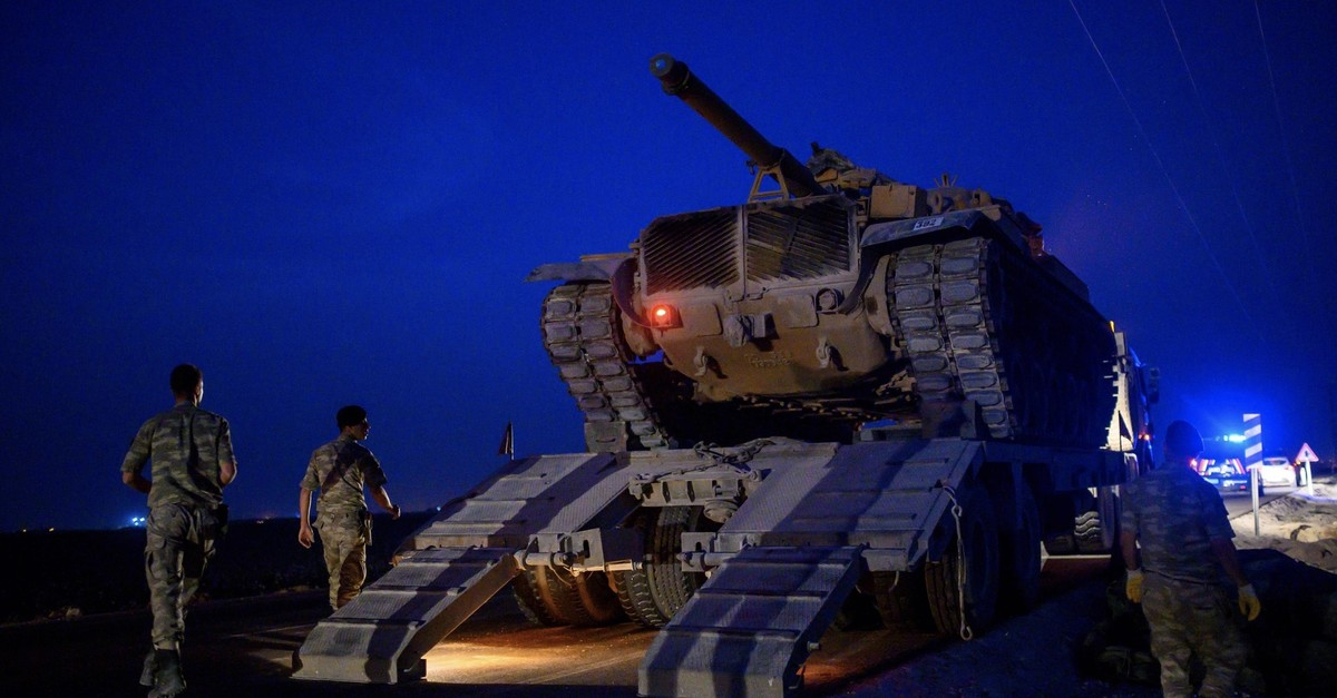 A Turkish army's tank drives down from a truck as the Turkish Armed Forces drive towards the border with Syria near Aku00e7akale in u015eanlu0131urfa province, Oct. 8, 2019.