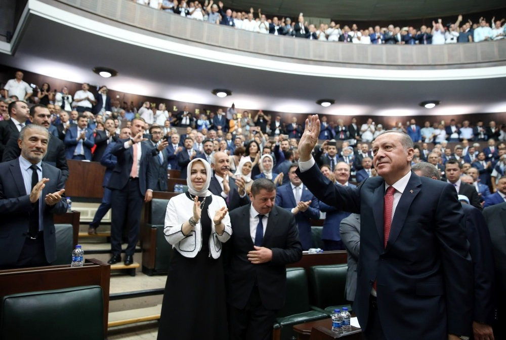 President Recep Tayyip Erdou011fan wave during the AK Party's group meeting in Parliament, Ankara, July 25.