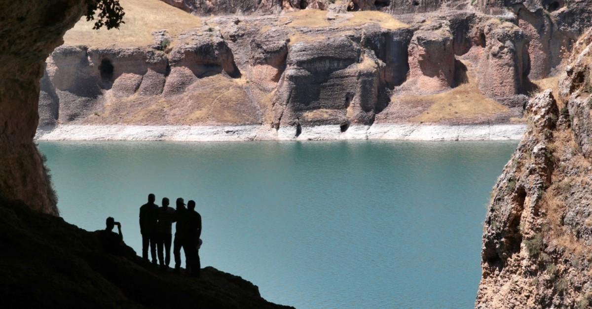Nature lovers admire the view from one of the caves in Saklu0131kapu0131 Canyon in Elazu0131u011f.