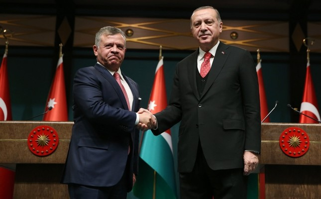 Jordanian King Abdullah II and President Recep Tayyip Erdoğan shake hands after a joint press conference at the Beştepe Presidential Palace in Ankara, Sep. 12, 2017. (IHA Photo)
