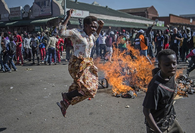 Opposition MDC party supporters protest in the streets of Harare during clashes with police Wednesday, Aug. 1, 2018. (AP Photo)