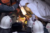 Baby pulled out alive from rubble 35 hours after 10-story building collapses in Russia's Magnitogorsk