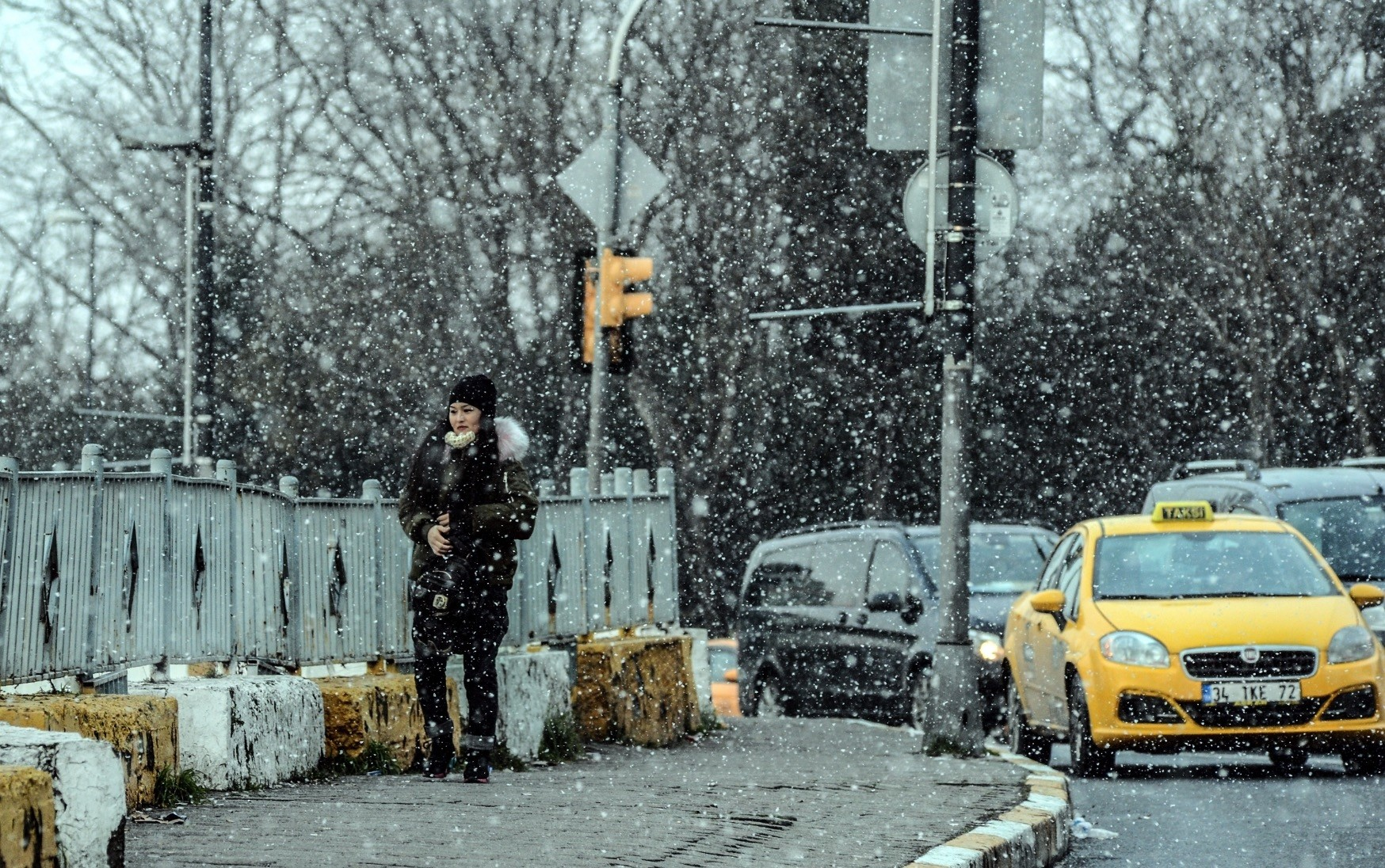 A woman walks under snowfall in Istanbul yesterday.