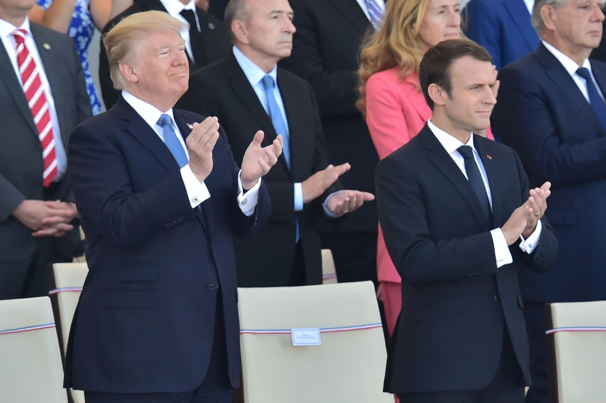 U.S. President Donald Trump (L) and his French counterpart Emmanuel Macron applaud as they watch the annual Bastille Day military parade on the Champs-Elysees avenue in Paris on July 14, 2017. (AFP Photo)