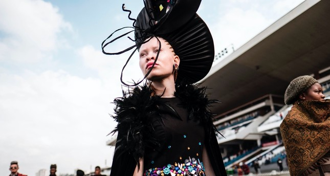 An Albino model presents a creation by a local designer during a fashion show at the 2017 Durban July horse race.