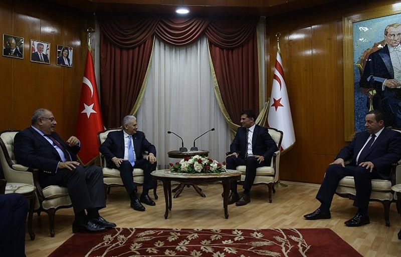 Turkey's PM Binali Yu0131ldu0131ru0131m (2nd left) meets with his Turkish Cypriot counterpart Hu00fcseyin u00d6zgu00fcrgu00fcn in the Turkish Republic of Northern Cyprus (TRNC) on March 9, 2017. (AA Photo)