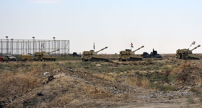 Iraqi army vehicles are seen parked near a former KRG military position on October 13, 2017 in the northern Iraqi town of Taza Khurmatu (a town near Tuz Khurmatu), near Iraq's oil-rich multi-ethnic province of Kirkuk. (AFP Photo)