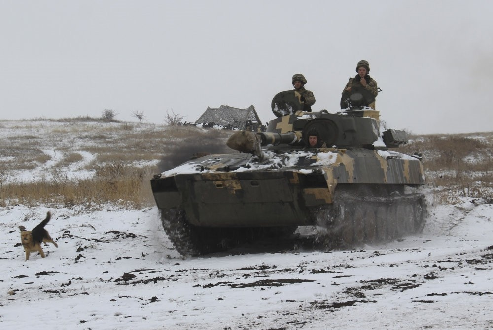 A Ukraine army APC moves into position at an undisclosed location in eastern Ukraine, Nov. 26, 2018.