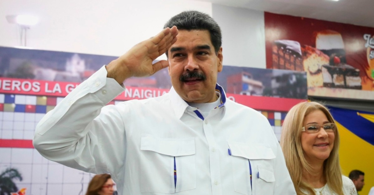Handout photo released by the Venezuelan Presideny of Venezuela's President Nicolas Maduro saluting next to his wife Cilia Flores during the inauguration of a passenger terminal in La Guaira, Venezuela, on Aug. 20, 2019. (AFP Photo)