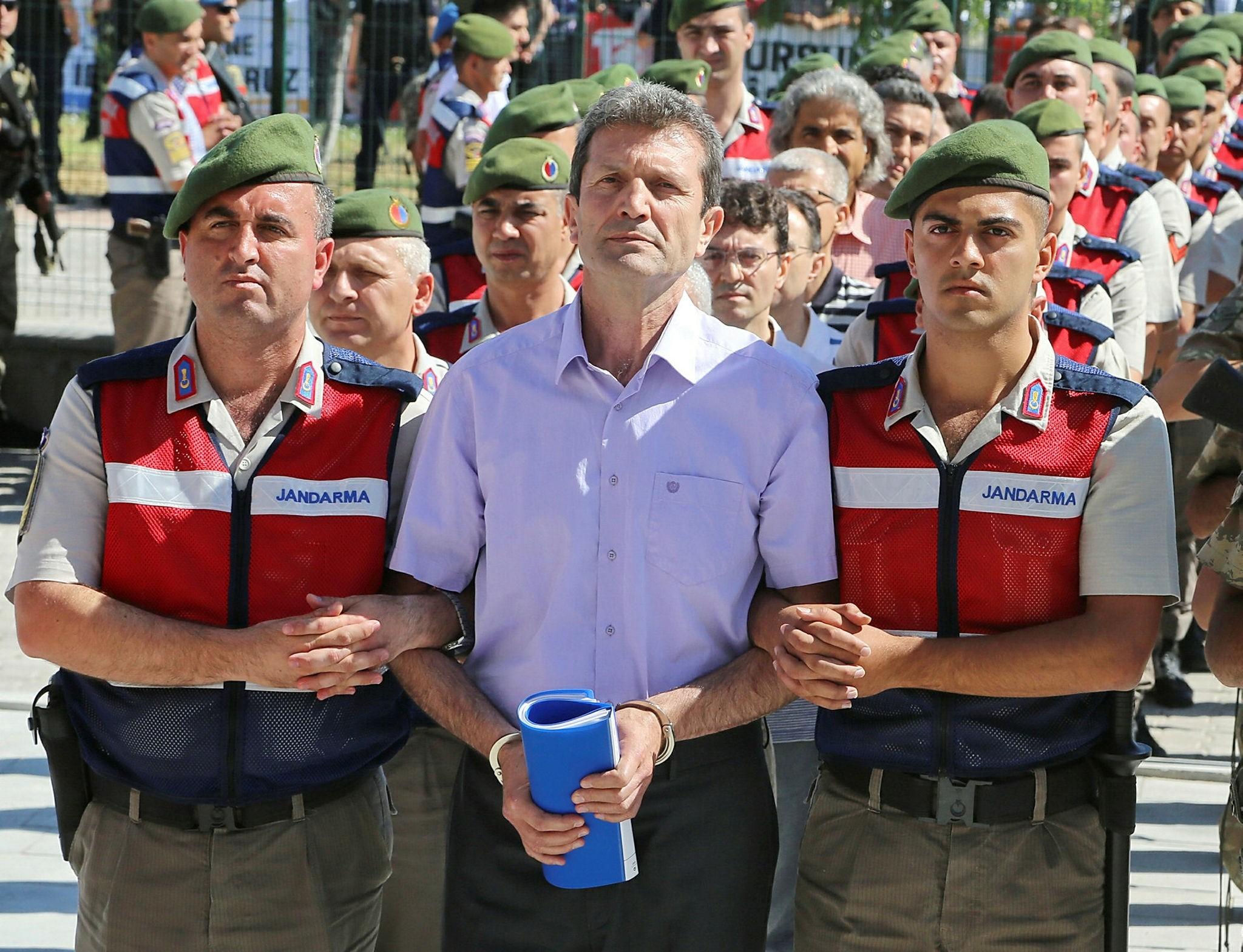 Gendarmerie troops escort Kubilay Selu00e7uk to court.