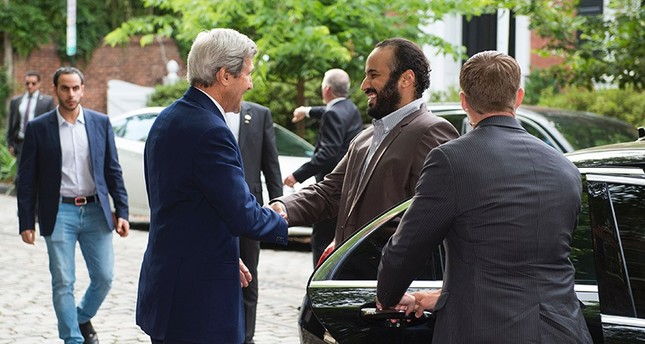US Secretary of State John Kerry (L) greets Saudi Deputy Crown Prince Mohammed bin Salman outside Kerry's residence prior to their meeting on June 13, 2016, in Washington, DC. (AFP)
